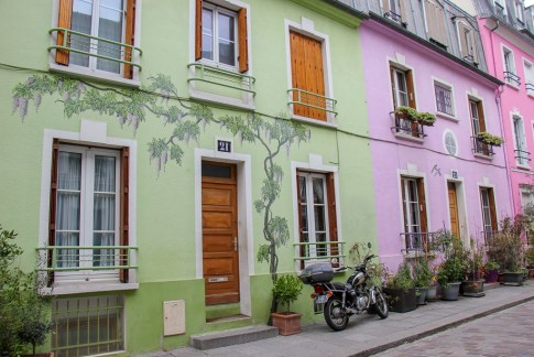 Pastel-painted houses on Rue Cremieux in Paris, France