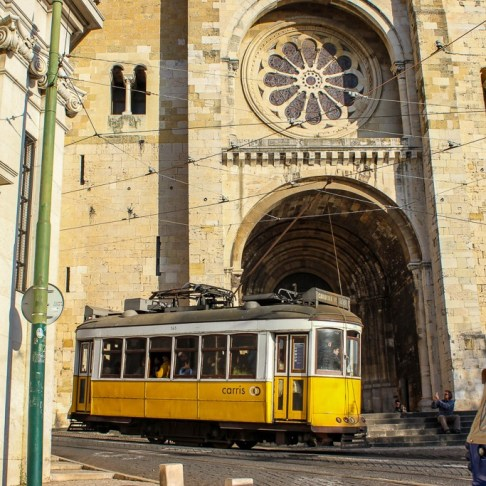 Tram 28 in front of Se Cathedral in Lisbon, Portugal