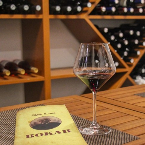 Glass of red Postup wine at Bokar Wine Bar in Korcula, Croatia