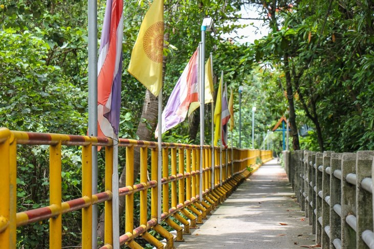 Flag-lined bike path in Bang Kachao in Bangkok, Thailand