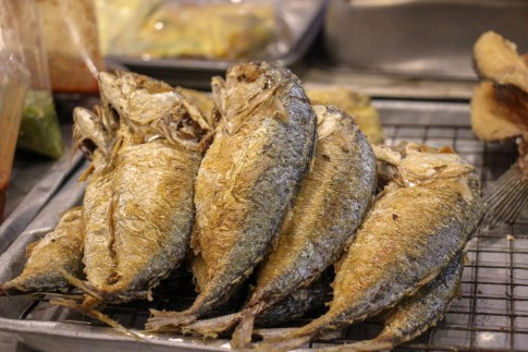 Whole grilled fish for sale at The Corner 79 Market in On Nut, Bangkok, Thailand