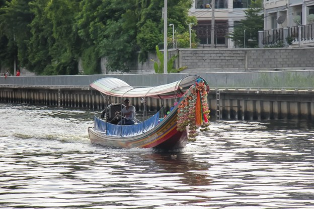 Long tail taxi boat on canal in Bangkok, Thailand