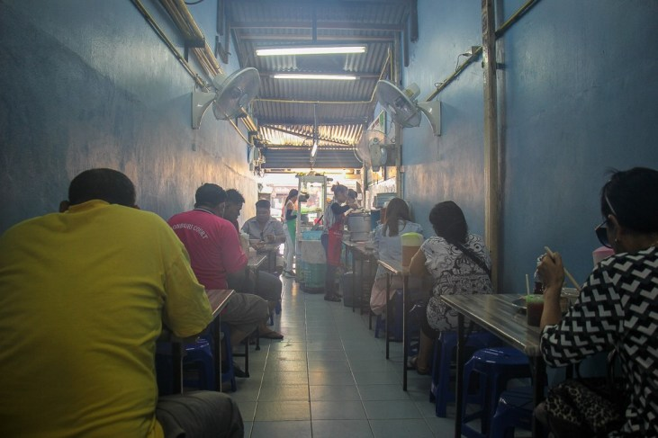 Dining area inside Pig Trotter restaurant in On Nut, Bangkok, Thailand