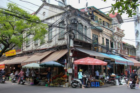Overhead jumble of wires on streets of Hanoi, Vietnam