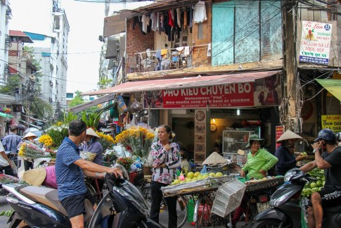 Makeshift market on street corner in Hanoi, Vietnam