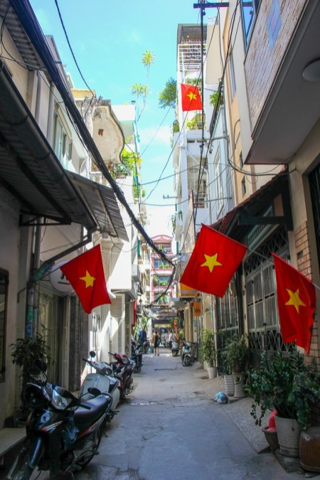 Vietnamese Flag down a walking street, Saigon, HCMC, Vietnam