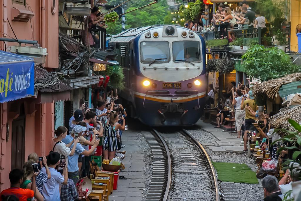 Train on tracks between houses in Hanoi, Vietnam