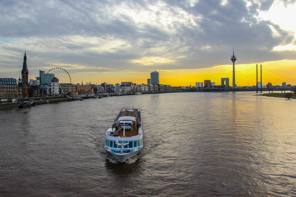 Rhine River at sunset with River Cruise, Dusseldorf, Germany