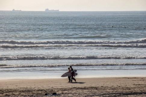Surfers on the beach at Matosinhos, Porto, Portugal