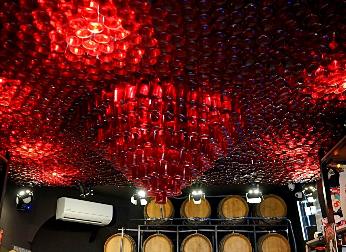 Ceiling made of the bottles with the cherry tincture at Drunken cherry