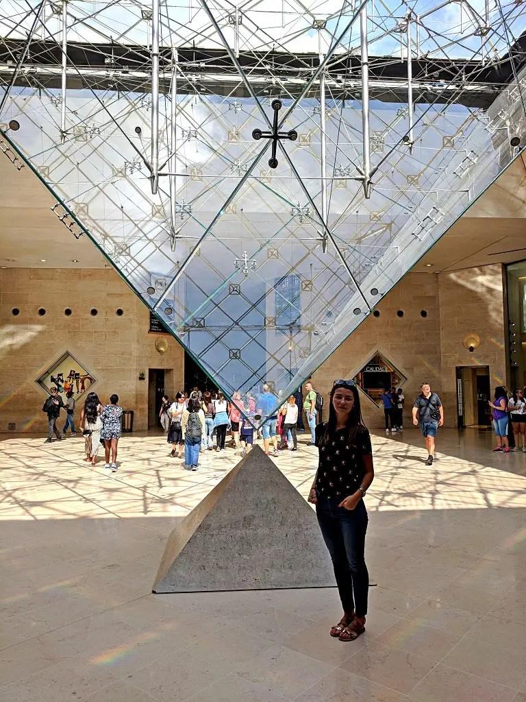 Alona next to the opposite pyramid