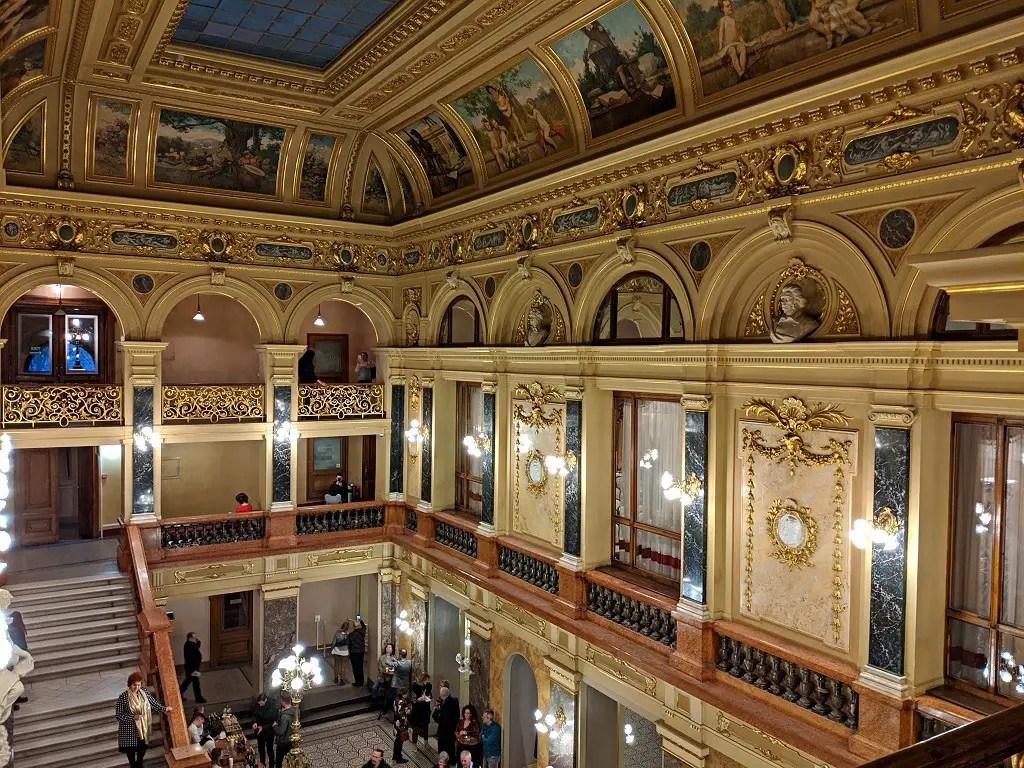 The ornate ceiling of the Lviv Opera House foyer