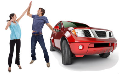 happy couple jumping next to suv