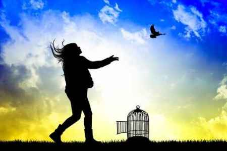 little girl and bird cage