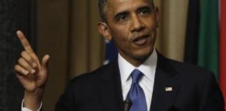 U.S. President Barack Obama answers question at joint news conference with South Africa's President Zuma in Pretoria