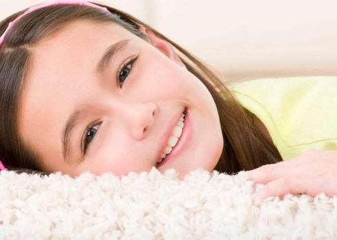 Girl Lying On Clean Carpet