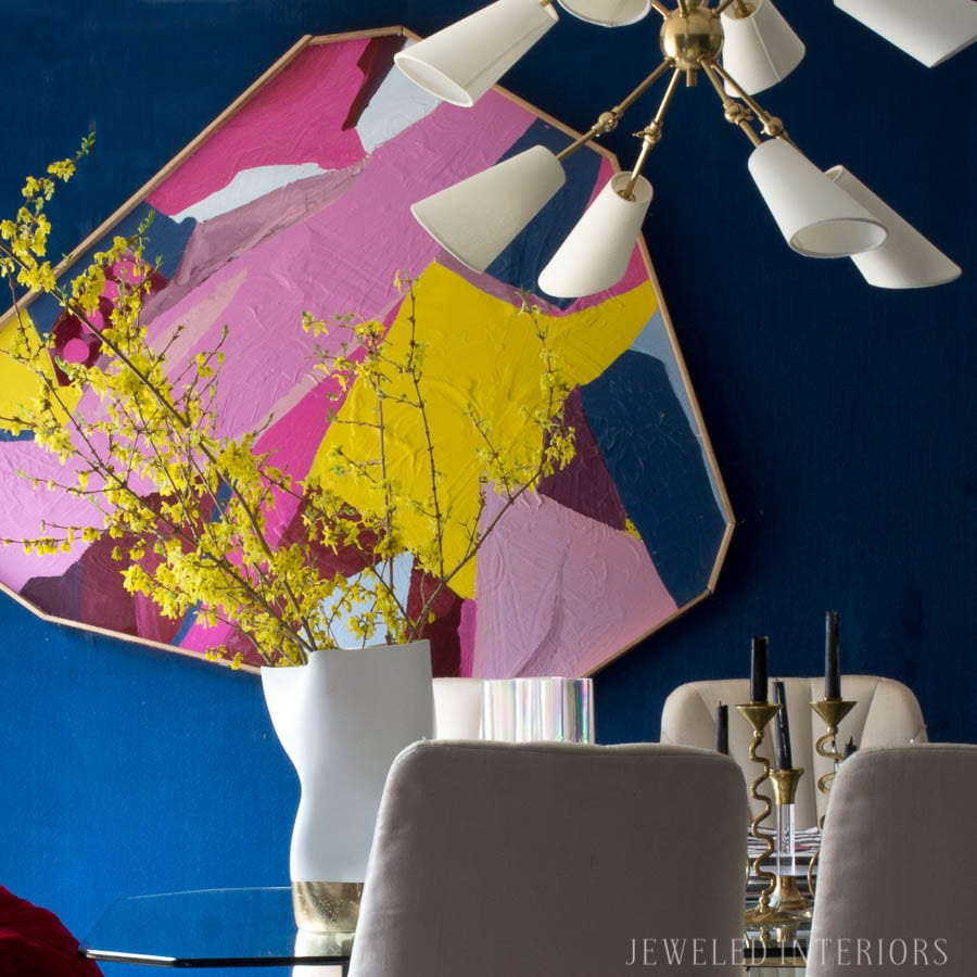This Chandelier is Da' Bomb! Check out this adjustable, brass, art deco Buckingham Chandelier, by Hudson Valley I got from Lamps Plus. I love this lighting in my dining room. Glass table, brass chandelier, bold color, DIY Art