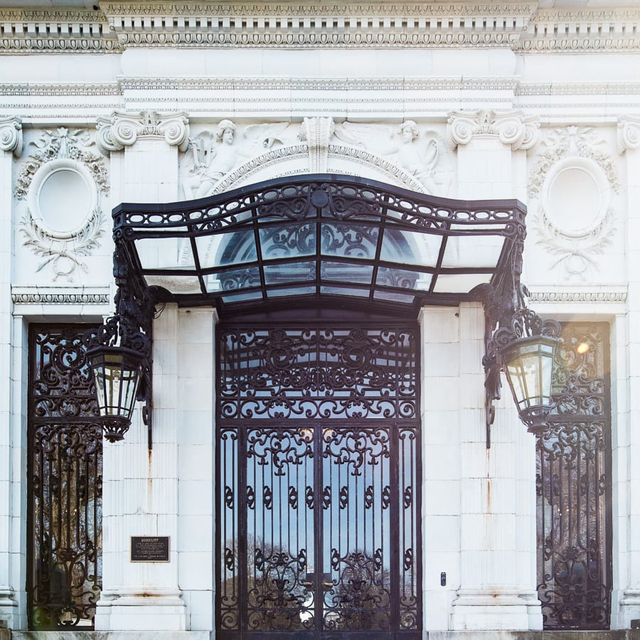 Looking for design inspiration and ideas? Does it surprise you to know that the mansions of Newport, Rhode Island have inspired my design choices? Check out the 6 lessons I learned from Rosecliff, a stunning Gilded Age Mansion. I dare you to try to resist being inspired by this stunning space. Gilded age, design ideas, mansion, door, wrought iron,