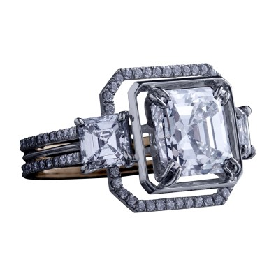A three-stone ring comprising an Asscher-cut Diamond weighing 3.00 carats and a matching pair of Asscher-cut Diamonds weighing 1.20 carats. Enhanced by an octagon of 1mm knife-edged wire and a band of 1mm 'floating' Diamond melee. Platinum set around a band of 1mm 18-karat yellow gold. Signed by artist. Crafted in the USA. One-of-a-Kind 1/1.