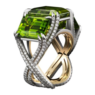 A three-stone emerald-cut Peridot ring totaling 21.04 carats, set with intricate intertwined bands adorned with Alexandra Mor's signature details of 262 'floating' Diamond melee and knife edged double spit prongs. Platinum set on 1mm 18-karat yellow gold band with Alexandra Mor logo gallery. 1.17 carat total Diamond weight. Signed by artist. Crafted in the USA. One-of-a-Kind 1/1.