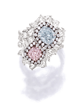 Set with a cushion-shaped Fancy Light Purplish Pink diamond weighing 1.00 carat and a cushion-shaped Very Light Blue diamond weighing 2.01 carats, decorated by variously-shaped diamonds together weighing approximately 1.40 carats, mounted in 18 karat white and pink gold.