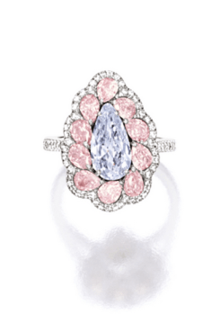 Centring on a pear-shaped very light blue diamond weighing 1.33 carats, surrounded by pear-shaped pink diamonds and diamonds together weighing approximately 2.00 carats, mounted in platinum and 18 karat pink gold.