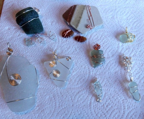 brooches, pendants in sea glass and sea pottery prices from €15 and up