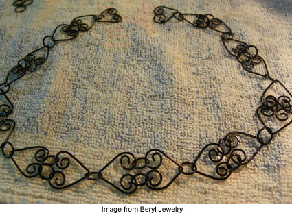 Beryl Morago's black heart wire necklace