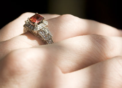 engagement ring with garnet setting