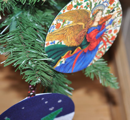 Christmas ornaments made from repurposed CDs and used holiday cards.