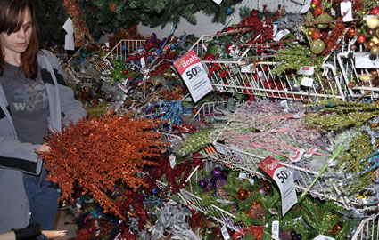 Counting stems in the glittery holiday aisle.