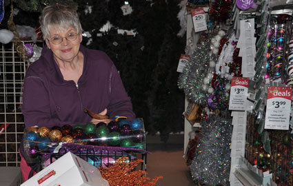 Mom looking at all the garland choices.