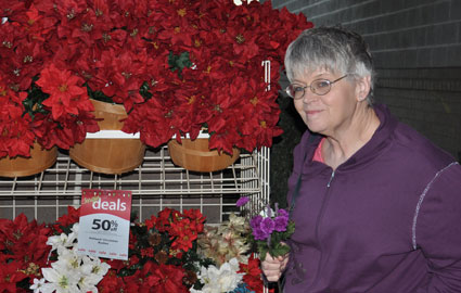 My Mtom lookiing at poinsettias