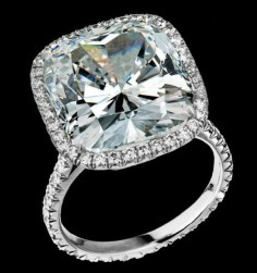 10.11-carat cushioned shaped diamond set on platinum and enhanced with round brilliant diamonds (1.05ctw).