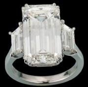 10.02-carat emerald-cut diamond ring with two diamond trapezoids mounted on platinum.