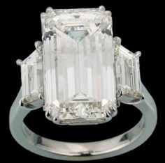 10.02-carat emerald-cut diamond ring with two diamond trapezoids mounted on platinum.