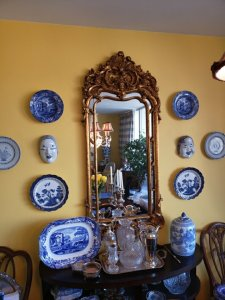 A view of the Dining room feature wall, with blue and white market finds.