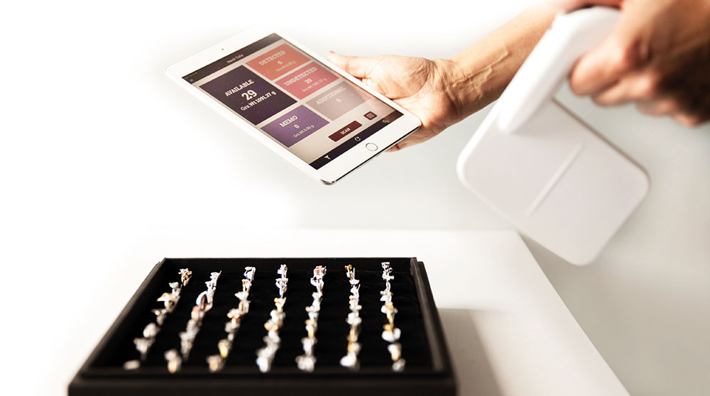 Jewelry store worker scanning inventory with JewelTrace RFID jewelry solution