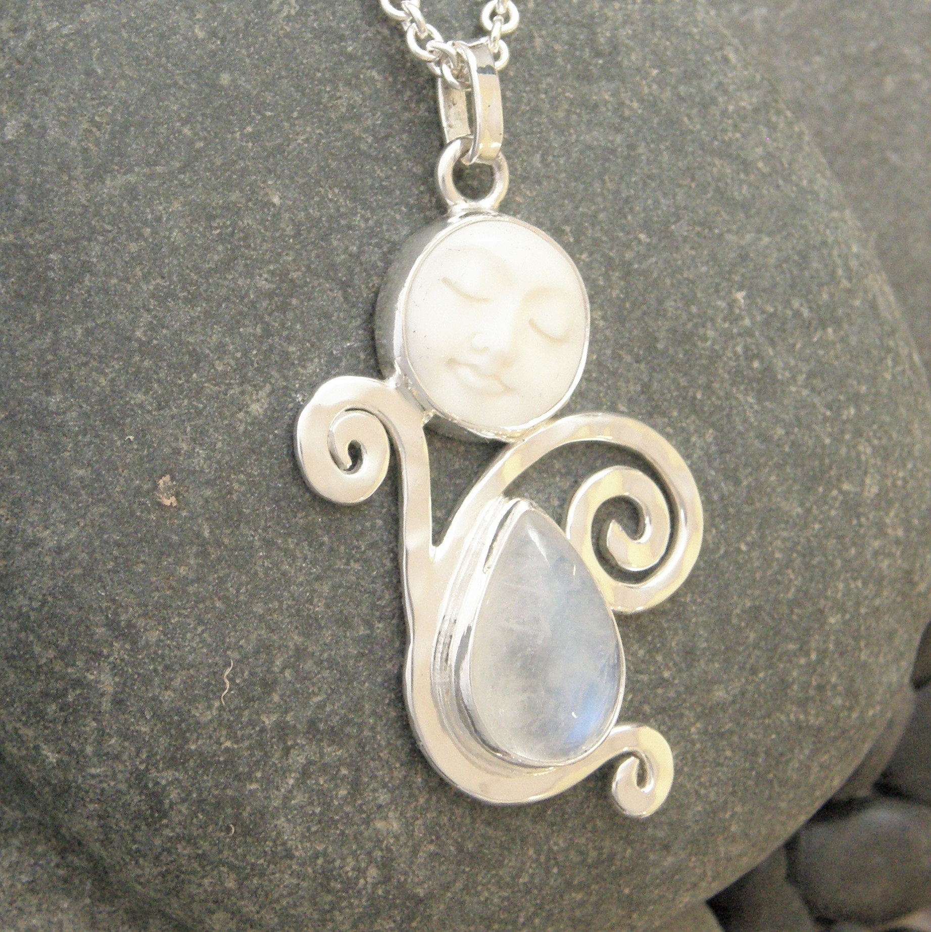 Hammered silver rainbow moonstone one of a kind queen of heaven rainbow moonstone carved bone face hammered silver moon goddess pendant aloadofball Gallery