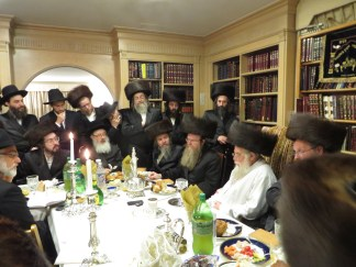 L seated Heshy Jacobs host of reception for Rebbe and 3rd from L Reb Berel Weiss Host of Melava Malka for Rebbe