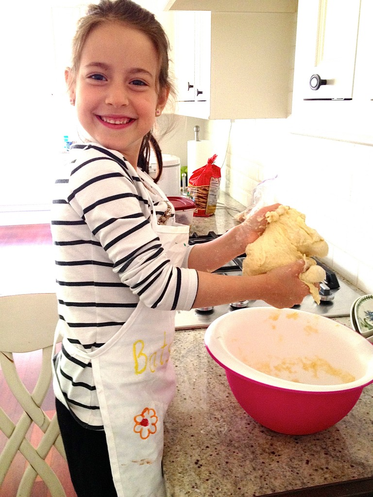 girl-kneading-challah-dough