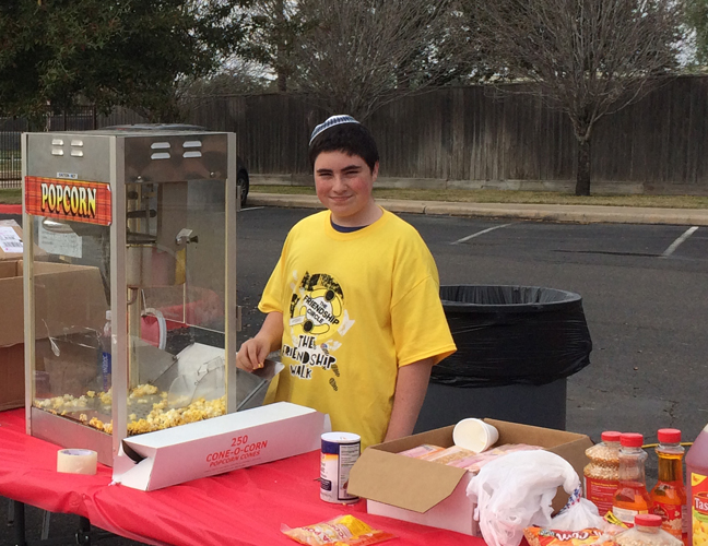 Esther's son, Natán, working his popcorn booth at the 2014 Friendship Walk Carnival