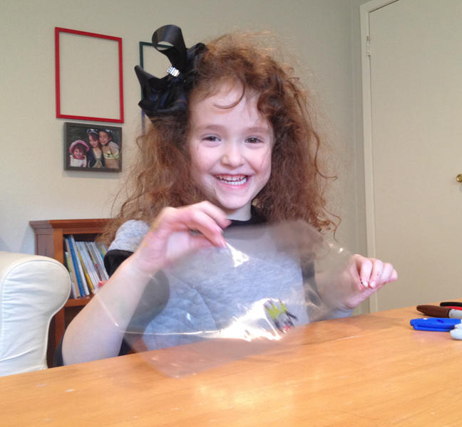 child making mishloach manot