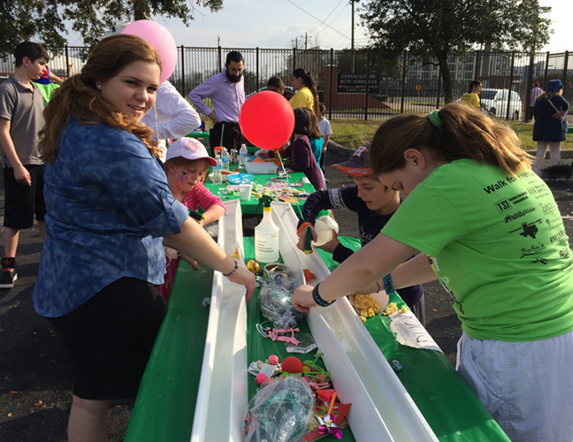 Esther's two daughters working at the 2014 Friendship Circle Walk Carnival