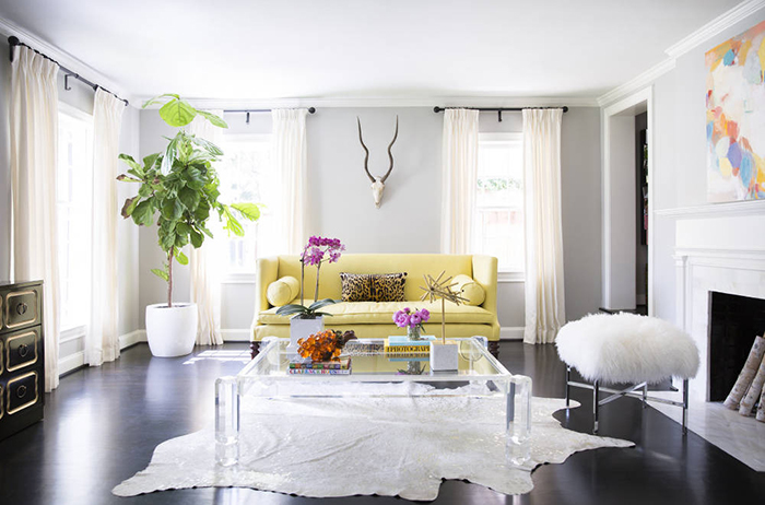 furry bench and lucite table on living room
