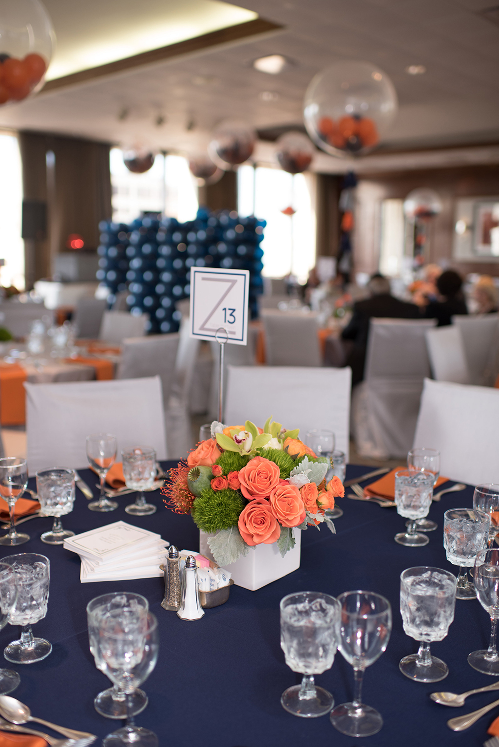 Bar Mitzvah Party Navy Tables with Orange flowers
