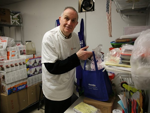 Jack Belitsky prepares food packages for delivery to vulnerable community members