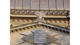 Detail on synagogue in Rome - A menorah and the Ten Commandments atop the synagogue in the Jewish ghetto in Rome, Italy (S. Cazon photo/Flickr.com under Creative Commons 2.0 license)