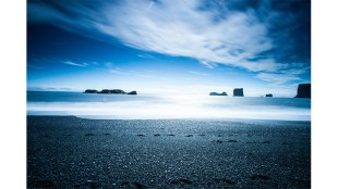 Long exposure shot near Dyrhólaey, Iceland. Photo by Claudio Büttler on Unsplash