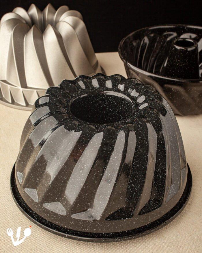 """I used the black enamel Riess 3 liter (14 cups) Gugelhupf bundt cake pan for the Yom Kippur yeast Gugelhupf bundt cake and the heavy cast aluminum the Gugelhupf bundt cake pan by Nordic Ware called """"Kugelhopf Bundt"""" for the coffee walnut marble Gugelhupf bundt cake."""